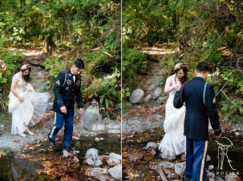 bride and groom crossing a river at treehouse point