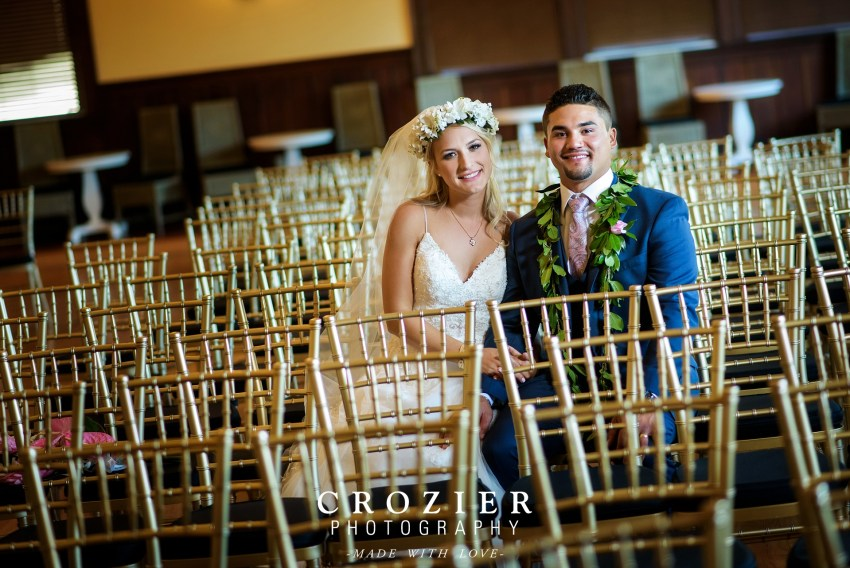 bride and groom sitting in the feather ballroom snohomish