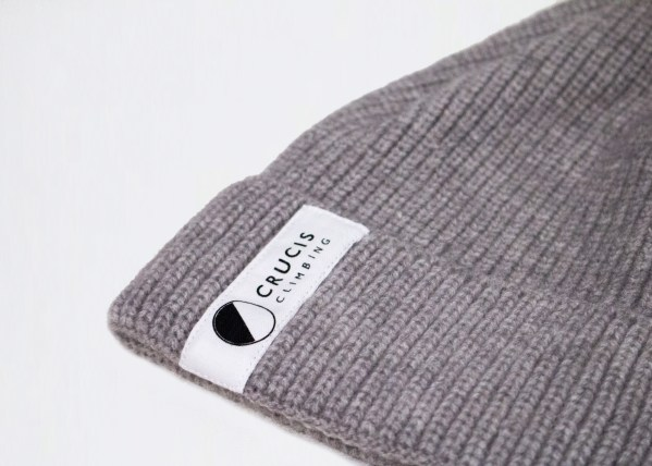 Grey winter wool hat with Crucis Climbing branding