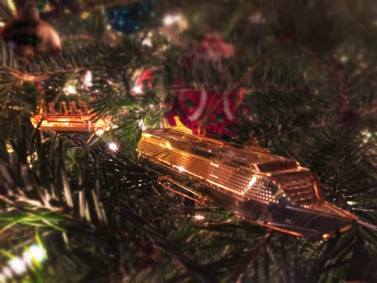 Freedom of the Seas and the Titanic sail around our tree.