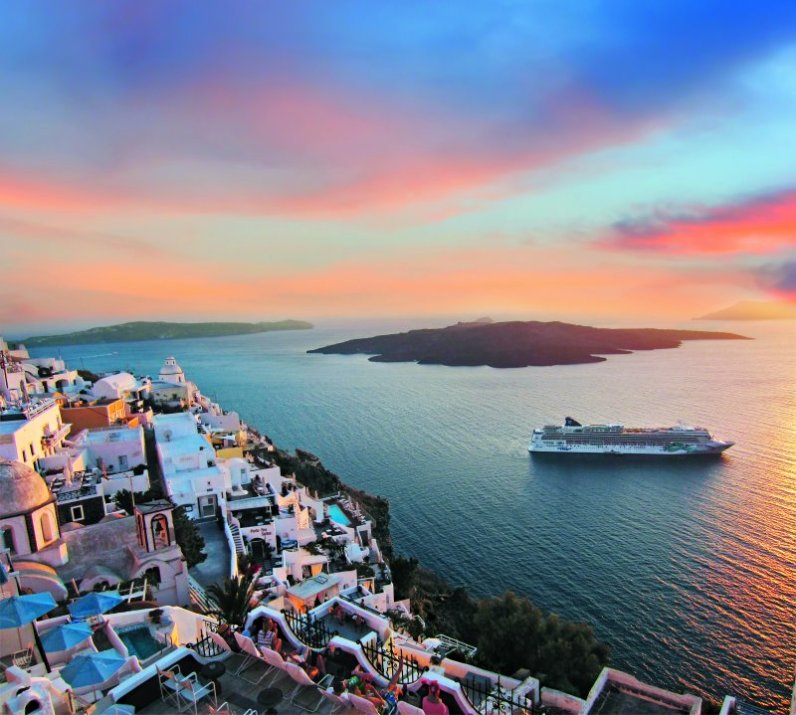 Norwegian Jade off the coast of Santorini Greece at sunset