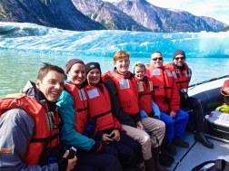 Family on skiff tour near a glacier