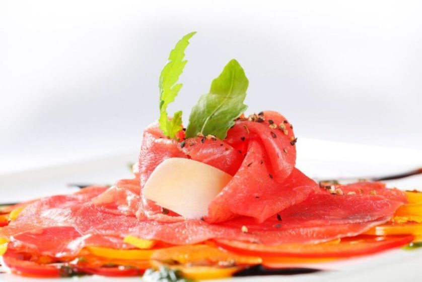 Beef Carpaccio on nest of thinly sliced bell peppers