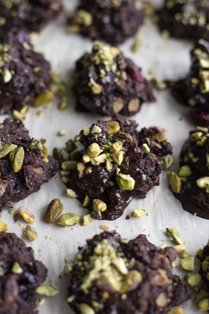 Up-close view of Cranberry Pistachio Cocoa Cookies on a baking sheet.