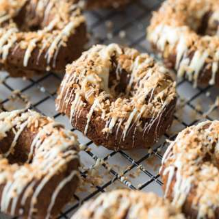 Up close view of Coconut Carrot Cake Protein Donuts on a cooling rack.