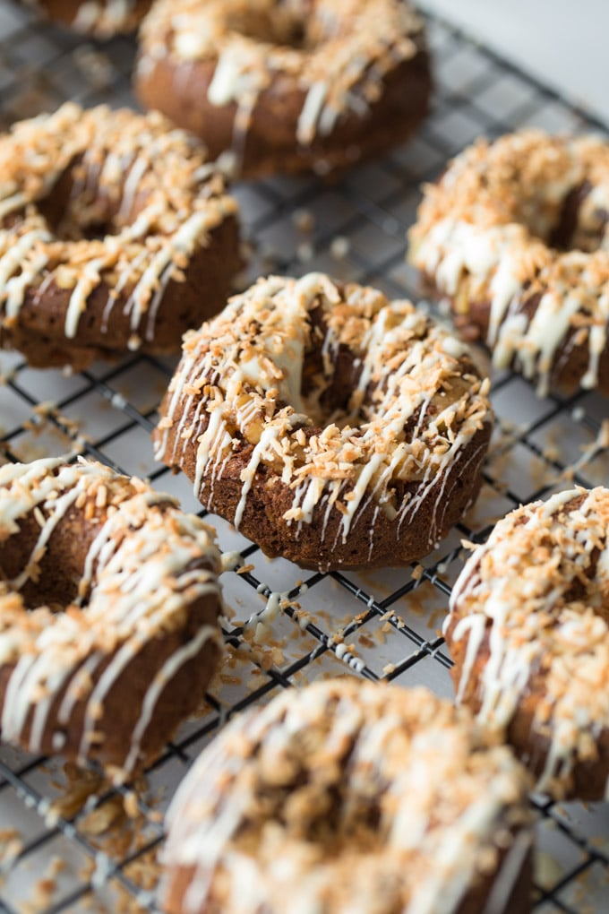 Up close view of Coconut Carrot Cake Protein Donuts on a wire cooling rack.
