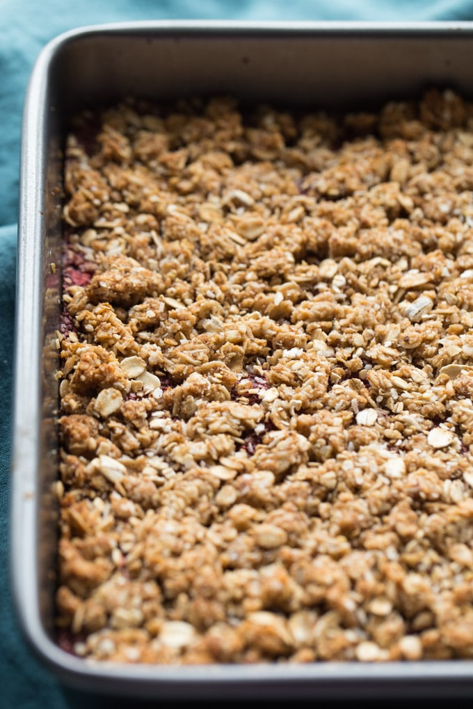 Up-close view of Strawberry Chia Jam Oat Bars in a square pan.