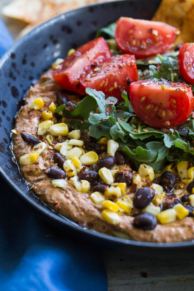 Up-close view of a Roasted Red Pepper and Black Bean Hummus Bowl.