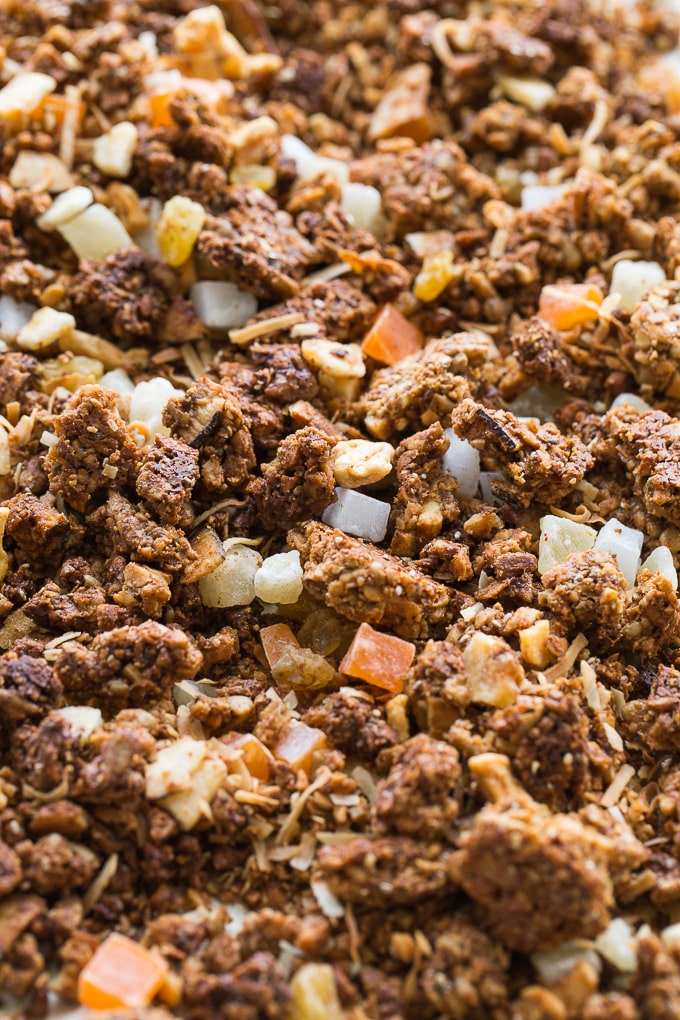 Up-close view of Coconut Cashew Crunch Grain-Free Granola spread out on a baking sheet.