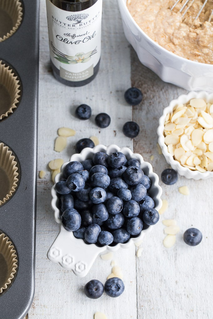 Overhead view of ingredients to make Blueberry Vanilla Almond Overnight Oatmeal Muffins.