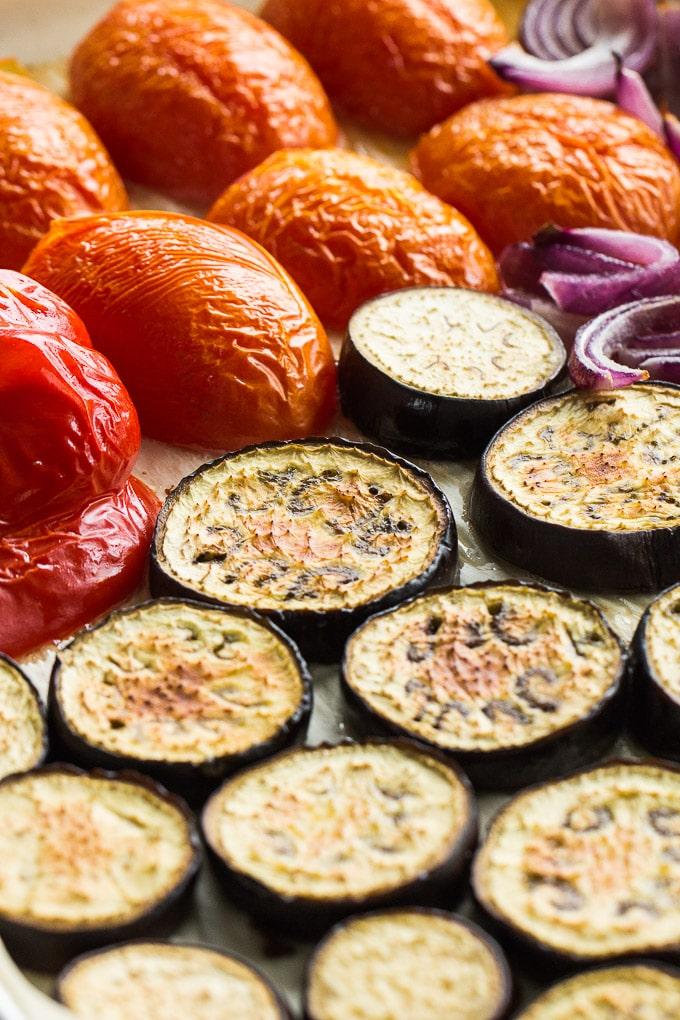 Up-close view of roasted vegetables on a sheet pan.
