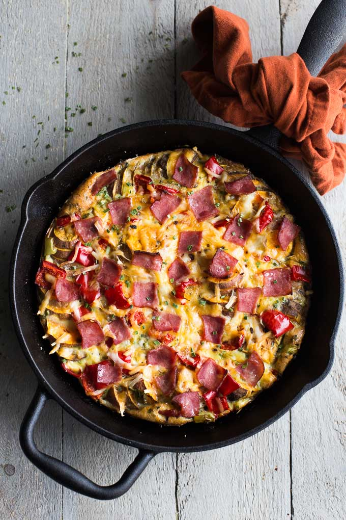 Overhead view of Savoury Sweet Potato Breakfast Skillet in a cast iron pan.