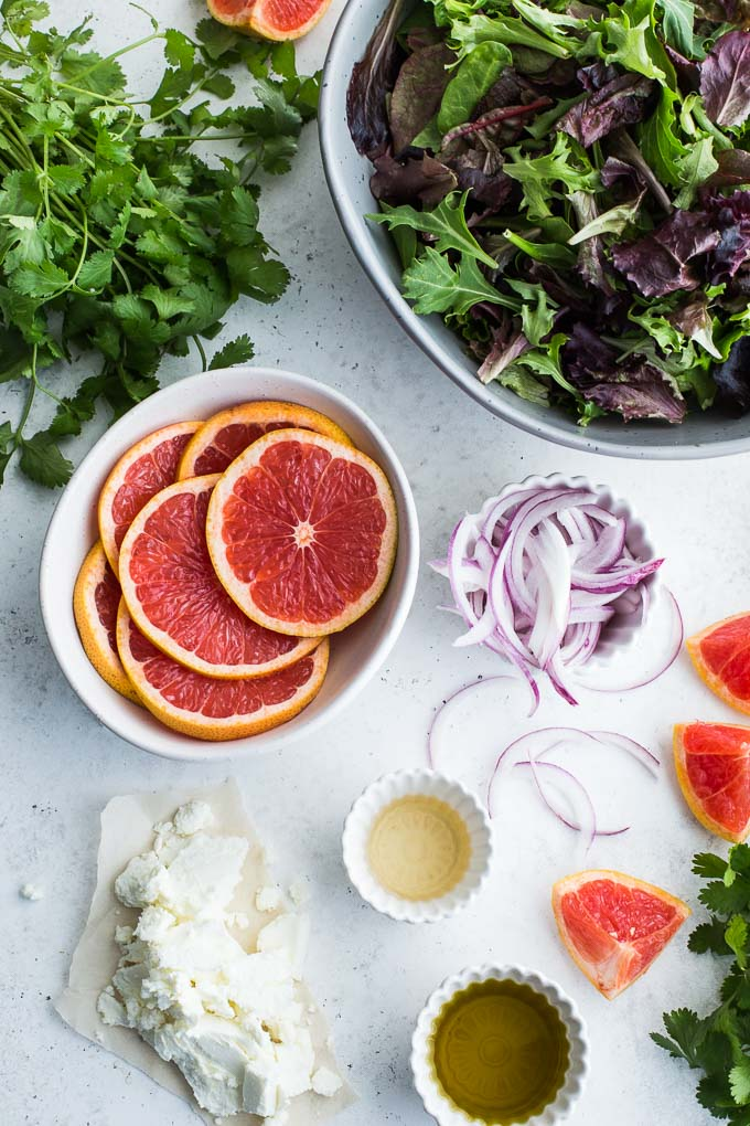 Overhead view of ingredients to make Grapefruit Salad with Cilantro and Goat Cheese.