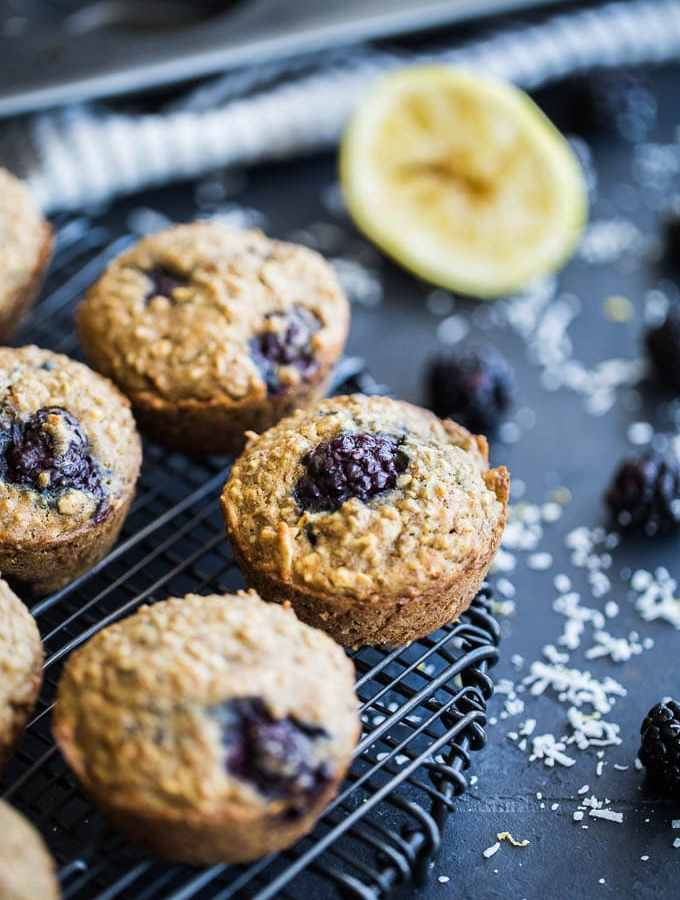 Up-close view of Blackberry Lemon Overnight Oatmeal Muffins cooling on a wire rack.