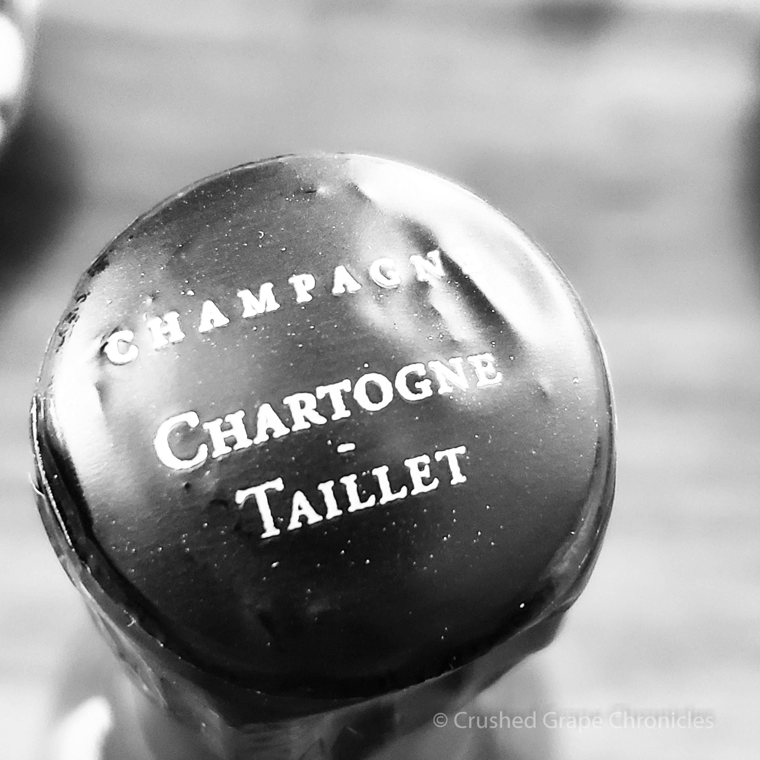 Anticipation...waiting to pop open this bottle.  The top of the bottle, cork still under the foil of Champagne Chartogne-Taillet