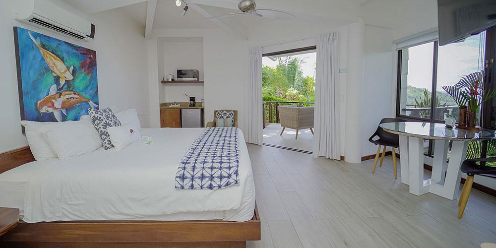 Sunset Hideaway Studio Bedroom and view1