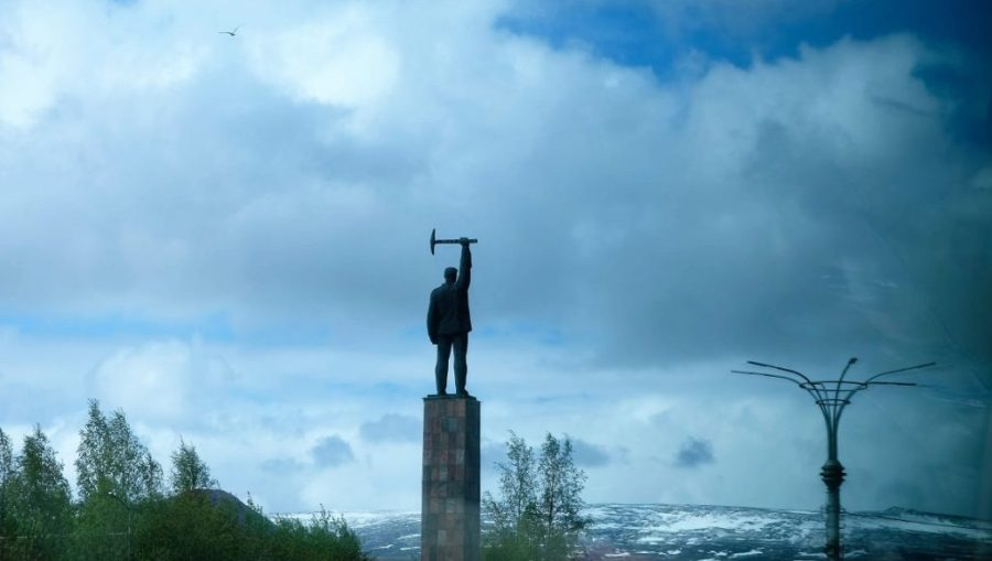 A statue of a miner guards the main road into Monchegorsk.