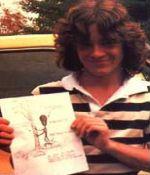 John Baxter con uno de sus dibujos