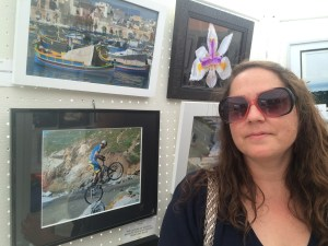 Darcy standing with her flower photo at the Fog Fest Photo Contest