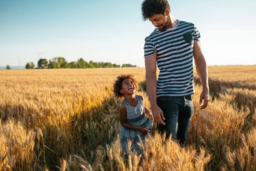 Father and daughter in a field