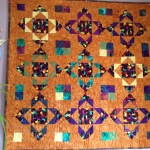 Quilt named Touching Ruby Jewell