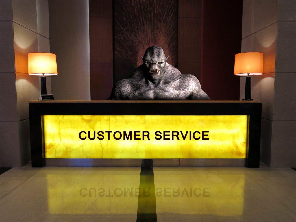 Scary Service monster behind customer service desk