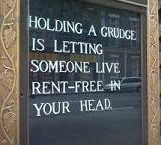 "Sign on window says, ""Holding a grudge is letting someone live rent-free in your head."""