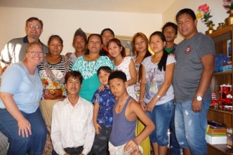 Kevin and Vicki Witte with 12 of their Nepali friends, former refugees now settled in Colorado. (photo provided by Vicki Witte)