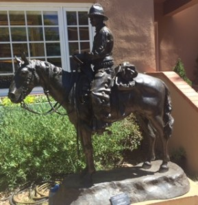 Bronze sculpture of cowboy on horseback