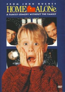 "Eight-year-old blond-hat Macaulay Culkin's holds hands to face, eyes wide and distressed, and mouth opened in an ""ah"" sound on the dvd cover of the movie Home Alone. Smaller images of the two burglars are behind him."