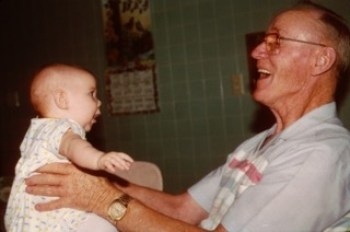Baby looks at happy Grandpa