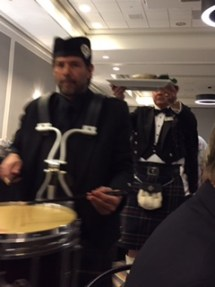 Drummer leads the server carrying the haggis.