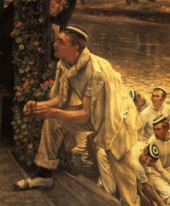 A man in boat sailing clothing has one foot up on the deck, while his fellow oarsmen are shown in the background. His expression is one of disbelieve and questioning.