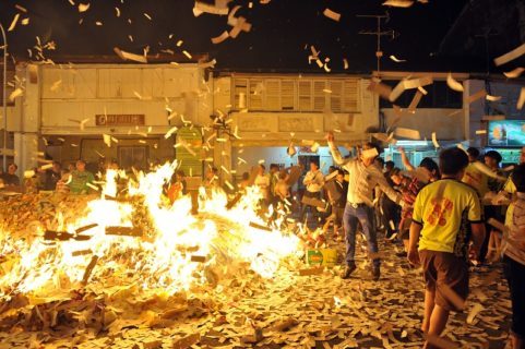 """crowd burning mounds of paper """"hell notes"""""""