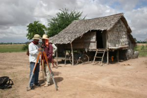 surveying outside of a hut