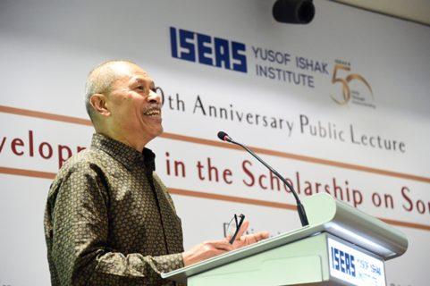 Dr. Leonard Andaya at a lectern