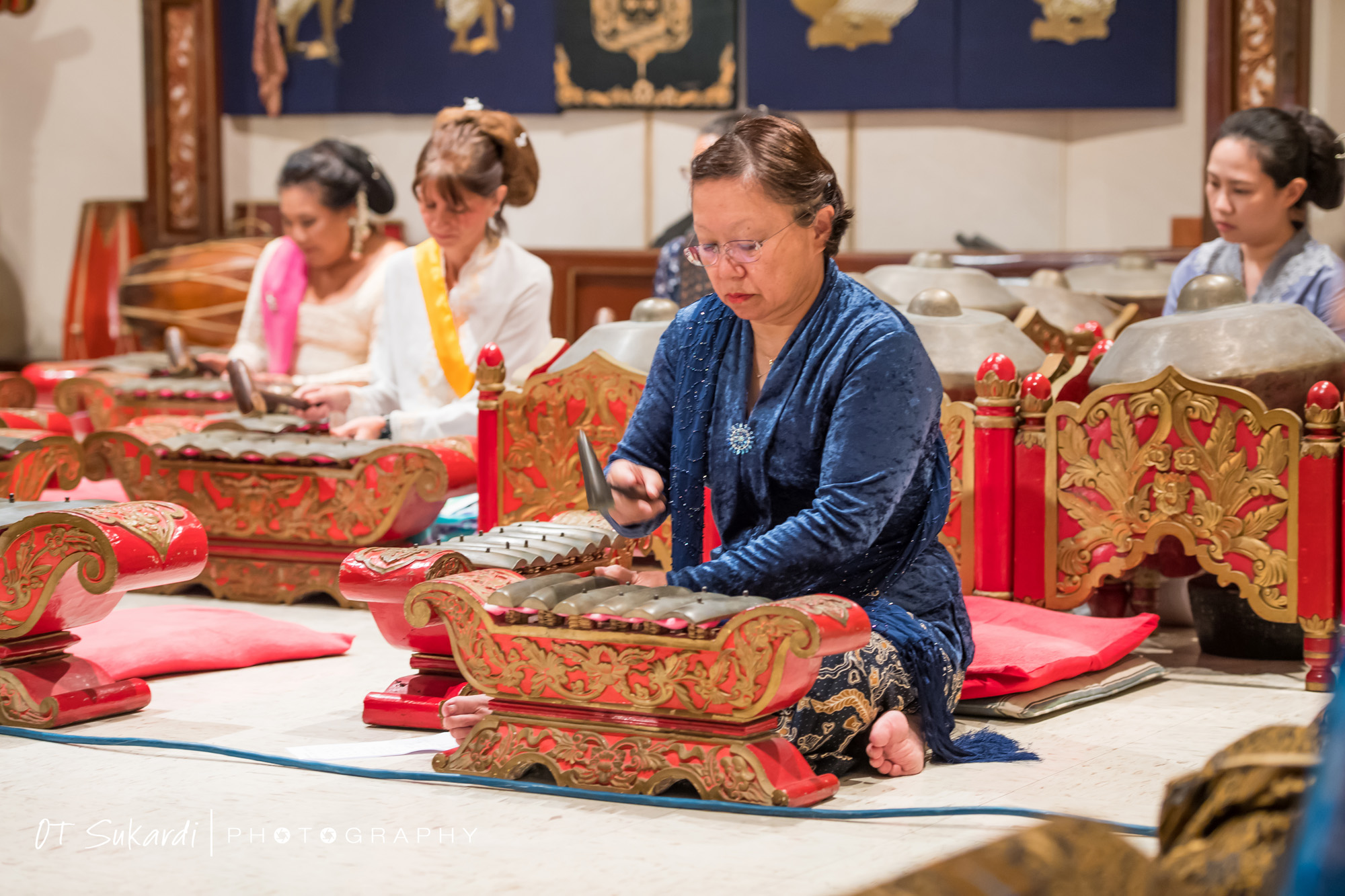 woman playing gamelan keys