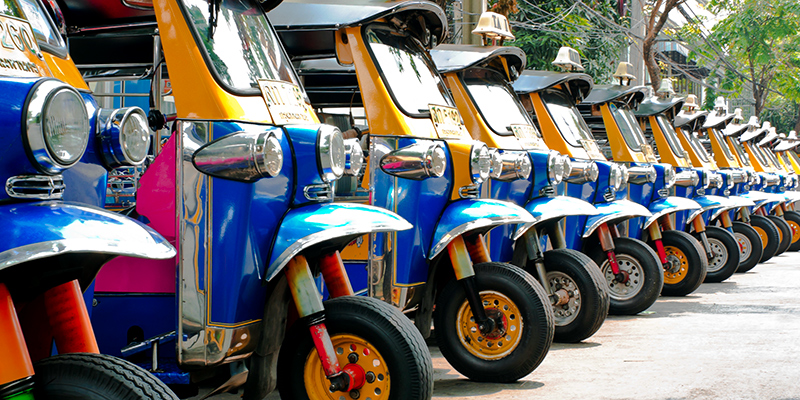 line of parked tuk tuks
