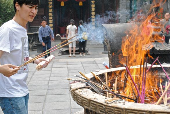 Photo by C.S. Hagen -- Burning incense in the Temple of the Heavenly Empress