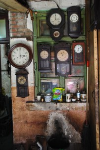 A clock repair shop in the old Japanese Concession - photo by C.S. Hagen