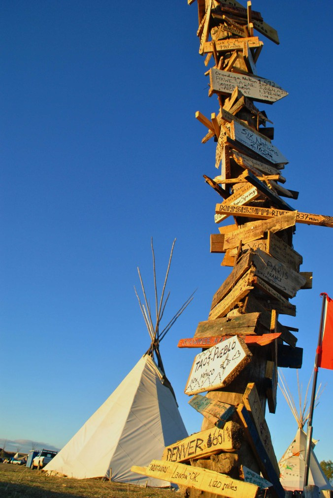 The signpost at Standing Rock Camp - photo by C.S. Hagen