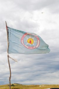 Standing Rock Sioux Tribe flag, Highway 1806 in background - photo by C.S. Hagen