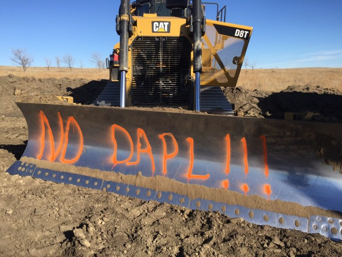 DAPL equipment spray-painted - photo provided by Morton County Sheriff's Department