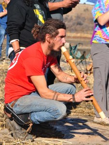 Pete Red Bear on elk flute - photo by C.S. Hagen