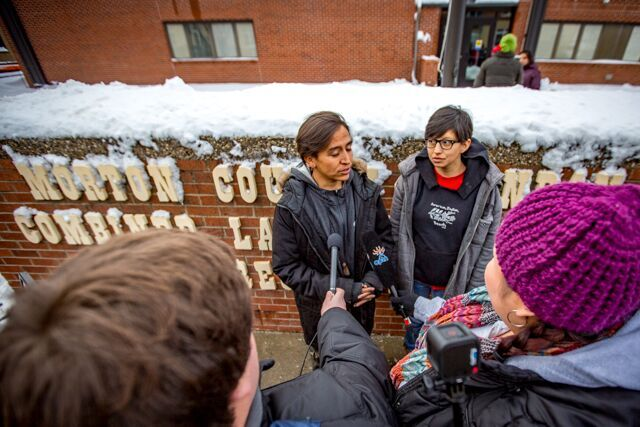Thomas Lopez speaks before activists give winter gifts to Morton County Sheriff's Department - photo by Chad Nodland