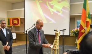 Deputy Consul General Mr. Asoka Godawita lighting the traditional oil lamp