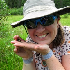 Melanie Murphy poses with a small frog in her hand