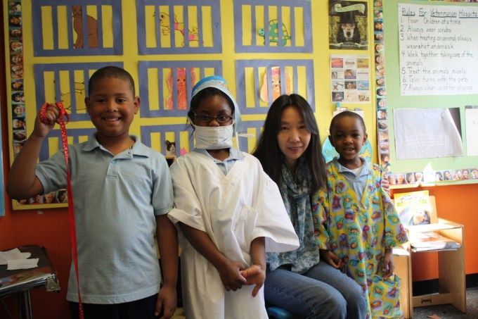 Denise Han with her students at Fletcher-Maynard Academy. The students created their own veterinary clinic, complete with costumes!