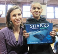 Greta and her buddy get a frisson of pleasurable fear reading about great whites.