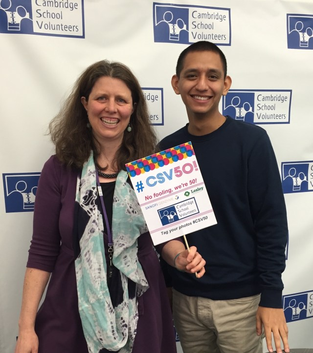 """Jennifer Fries, CSV'sexecutive director, and Ivan Valdovinos, our intern from the Harvard Graduate School of Education, try out the props for thephoto """"booth"""" we're making available for guests at CSV 50!."""